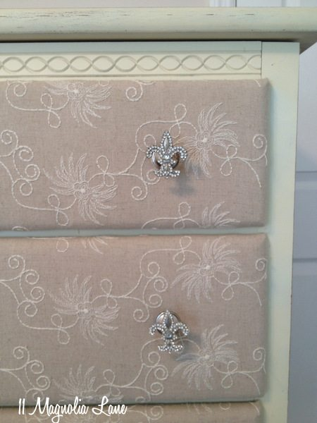 Painted dresser with fabric-covered drawers