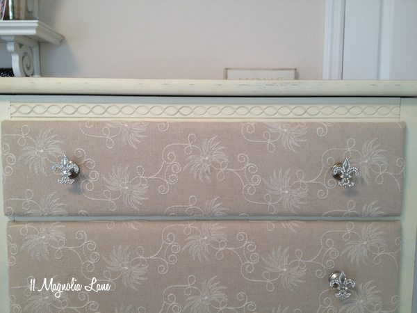 Close up of fabric-covered drawers