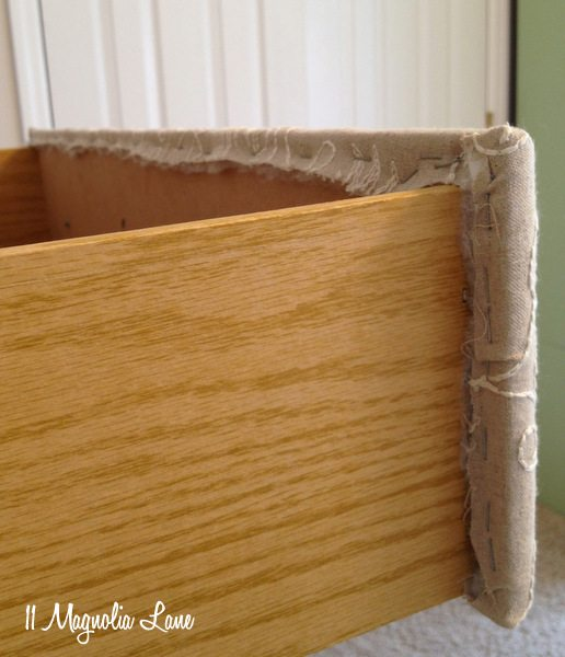 Staple fabric to the inside of the drawer