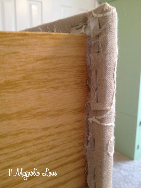 Staple fabric and batting to inside of drawer front