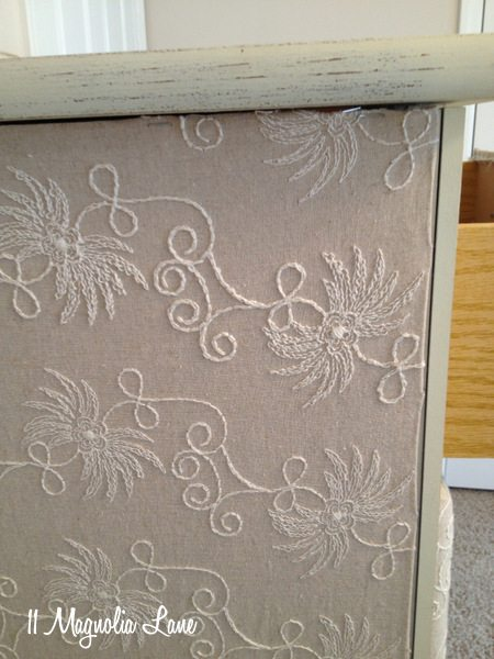 Side of fabric-covered dresser