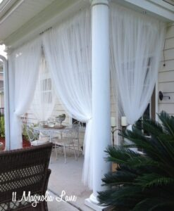 Sheer panels on covered porch