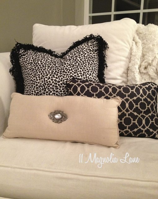 white chair with black white neutral pillows