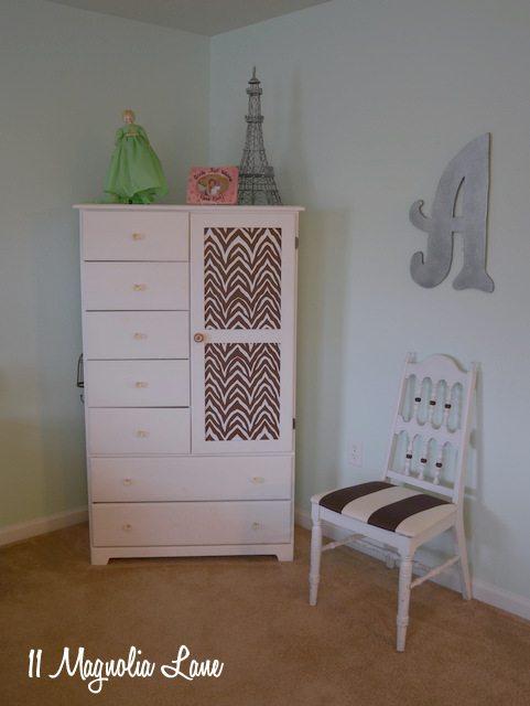 armoire with shelf paper fabric on door panels