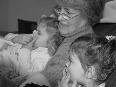 mom reading to grandkids