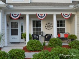 Fourth of July front porch with red, white, and blue bunting