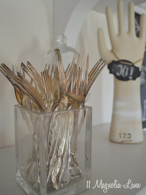 silver forks on display
