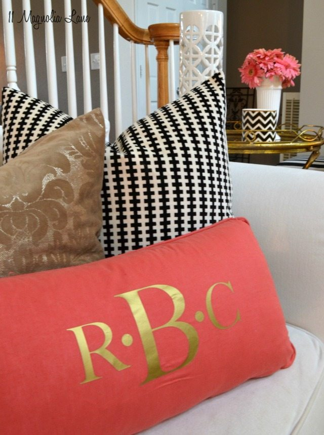 Living room in gold, pink, and black