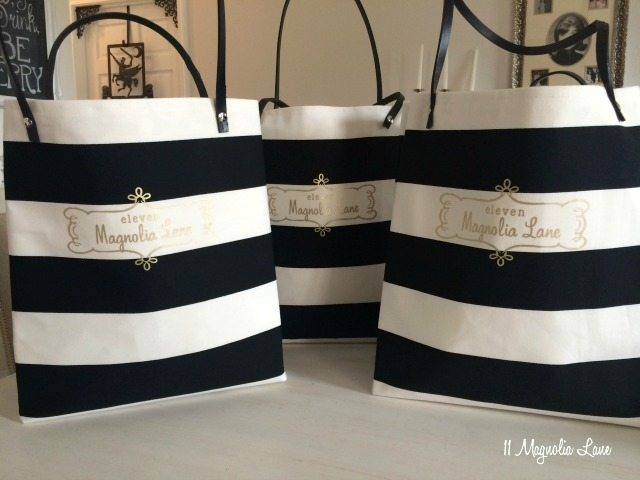 Black and white striped tote bags with gold logo