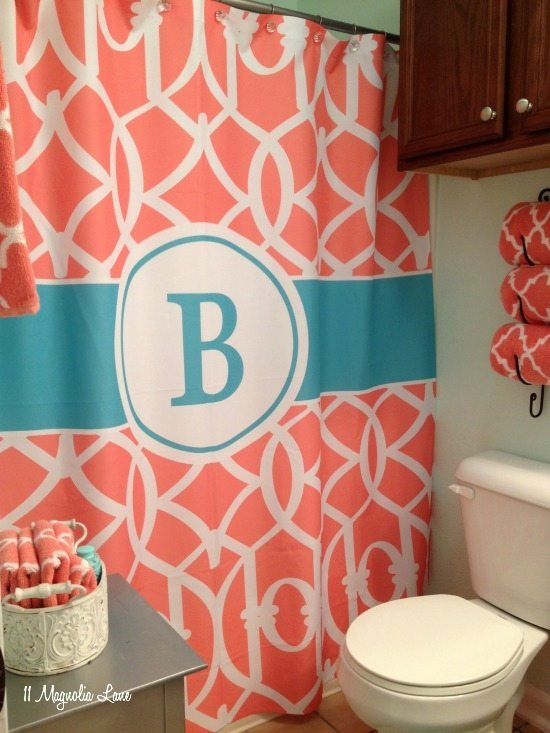 Girl's bathroom in aqua blue and coral pink | 11 Magnolia Lane