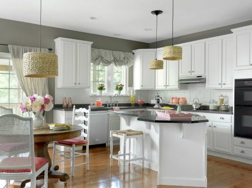 Black granite island in white kitchen
