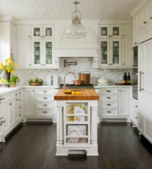 Butcher block island with white cabinets
