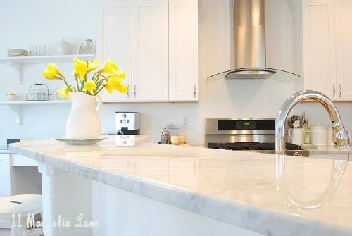 White kitchen with marble countertops | 11 Magnolia Lane