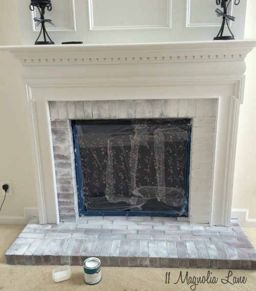 whitewashed-brick-fireplace