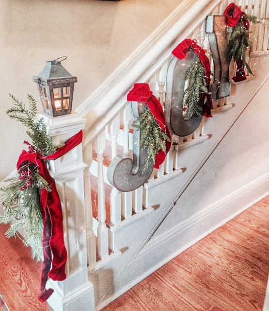 JOY Christmas banner on staircase from galvanized metal letters | Quarters One