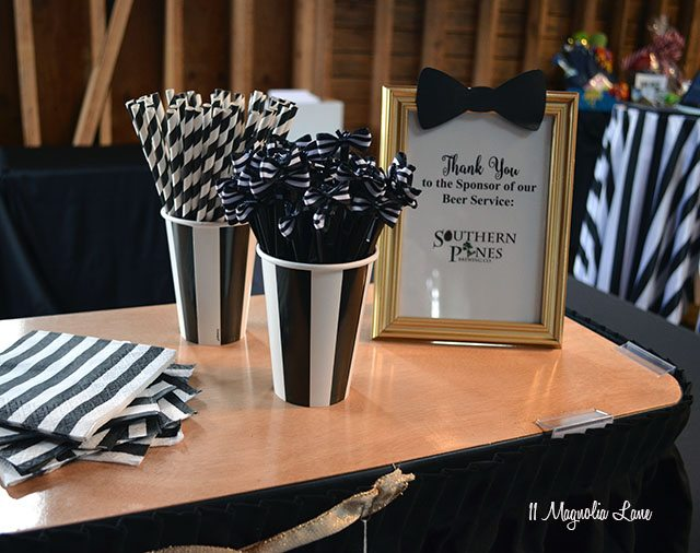 Bowtie swizzle sticks; Formal event decor: black and white stripes with gold