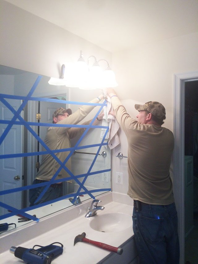 pulling-down-large-bathroom-mirror