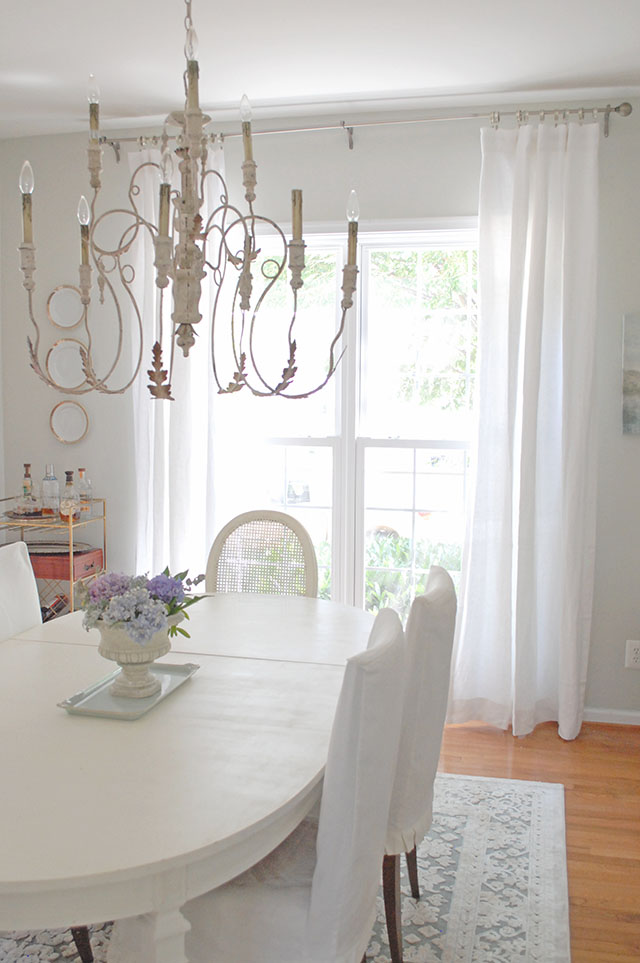 Dining Room with white furniture and gray walls., white linen curtains