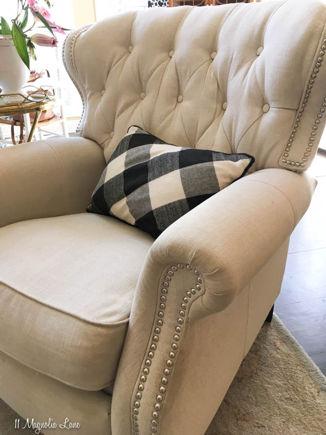 This beautiful recliner is perfect for couples--it's super comfortable, so guys love it, but it's also beautiful, so ladies love it, too! It features linen look fabric with tufting and nail head trim. | 11 Magnolia Lane