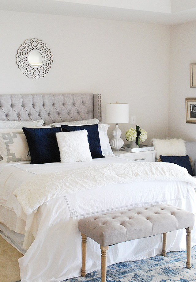 Winter master bedroom updates with affordable headboard options, blue and silver color scheme.