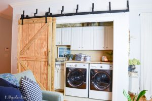Laundry room closet with DIY sliding barn doors | 11 Magnolia Lane