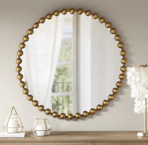 Gold beaded mirror