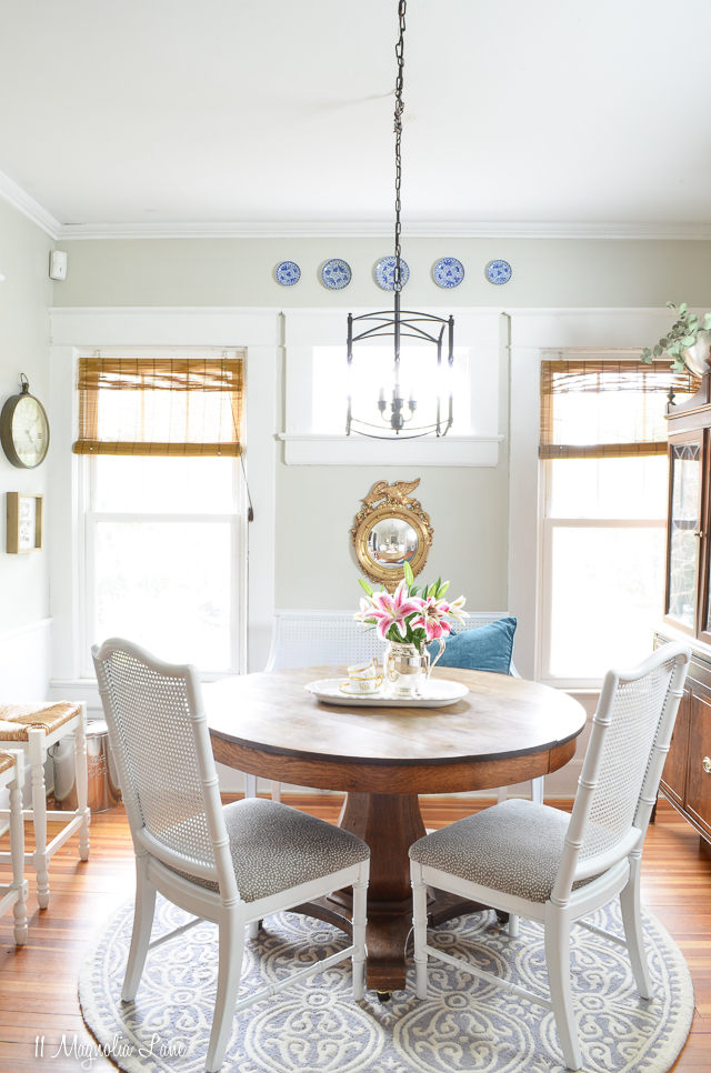 Vintage French cane bench used as dining banquette | 11 Magnolia Lane