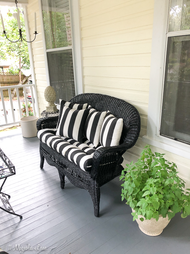 Magnolia Cottage front porch with black and white awning striped cushions | 11 Magnolia Lane