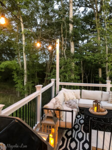 Adding outdoor cafe lights to an elevated deck