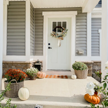 craftsman style front porch decorated for fall
