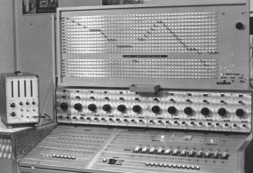 Two-instruments-designed-by-Walter-Landrieu.-Top-rhythm-programmer-for-the-tracking-of-a-waveform-through-a-patch-bay.-Centre-bank-of-12-tone-generators-with-a-choice-between-different-waveforms.-Left-frequ