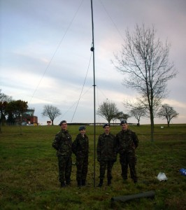 Cadet Sergeant Scott Goodall with other cadets from Central and East Region in front of their mast.