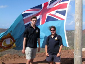 Sergeant Alex MacRae and Flight Lieutenant Kirsty Burnham with the Corps Ensign