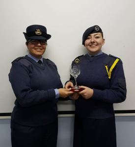 CWO Mowatt receiving her goblet from the CO