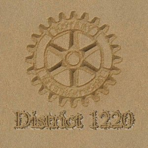 District 1220 in the sand logo