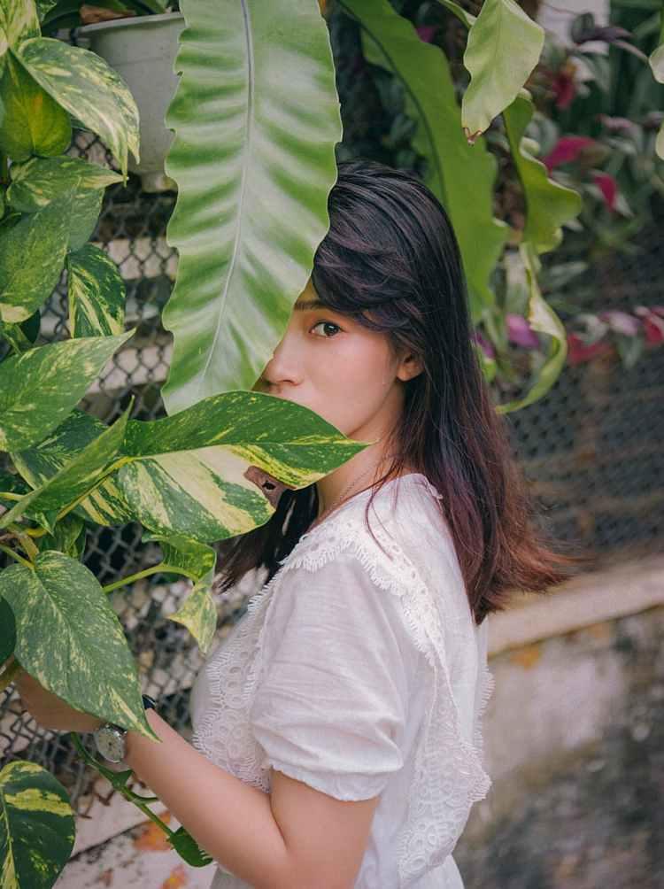photo of woman near plants