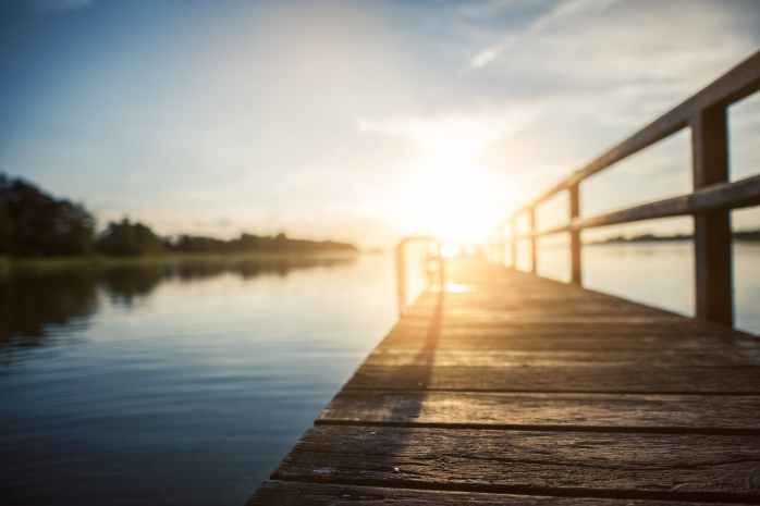 low angle photography of brown wooden dock at golden house