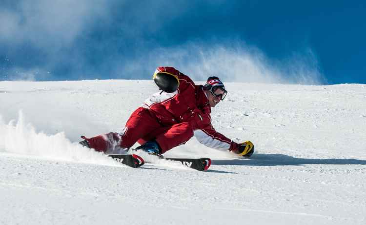 man on ski board on snow field
