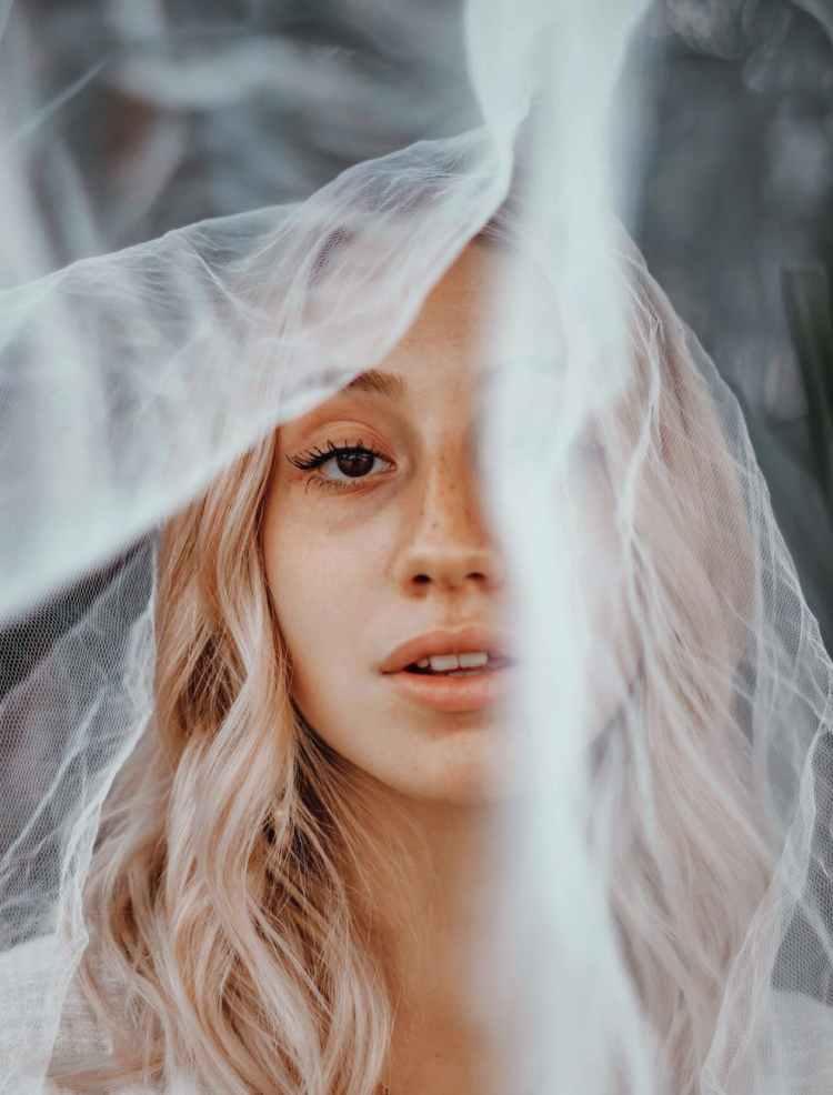 crop woman with translucent veil