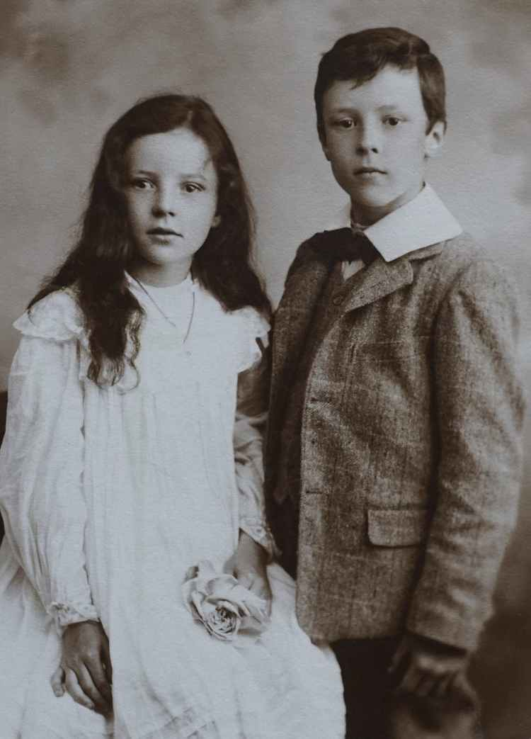 a vintage photo of lovely siblings