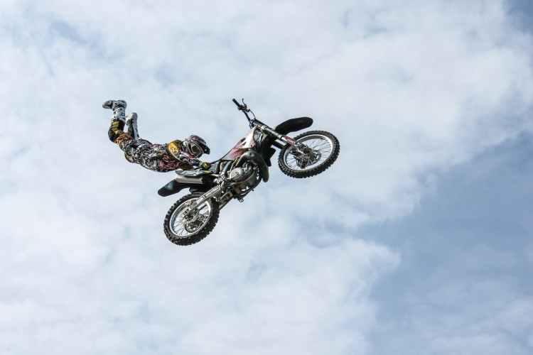 motorcycle rider doing stunts in midair
