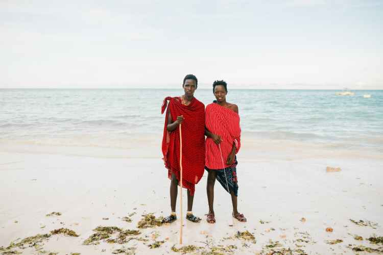 ethnic father and son standing on beach