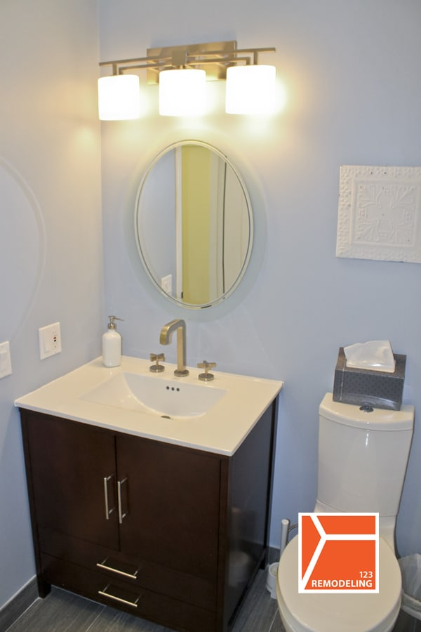 Slim, elongated modern styled toilet installed by 123 Remodeling creates more space and visually bigger bathroom.