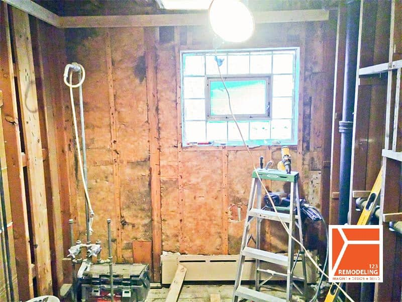 Existing tile removal taken place during demolition phase pf kitchen remodel at 6342 N. Natoma Ave, Chicago, IL