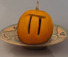 pumpkin carved with the symbol for pi