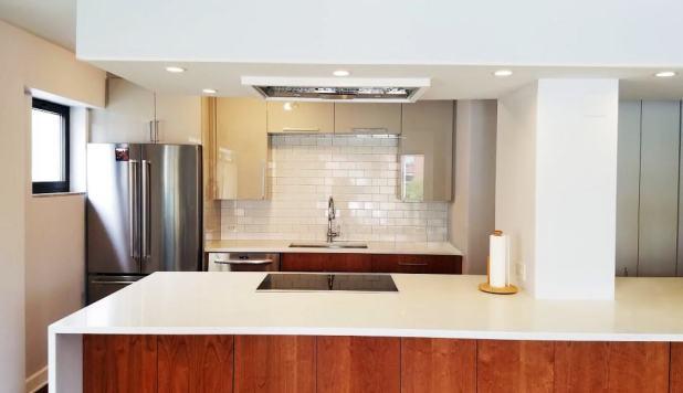 This kitchen uses engineered quartz countertops