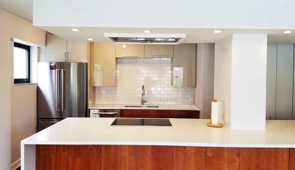 This kitchen uses engineered quartz countertops