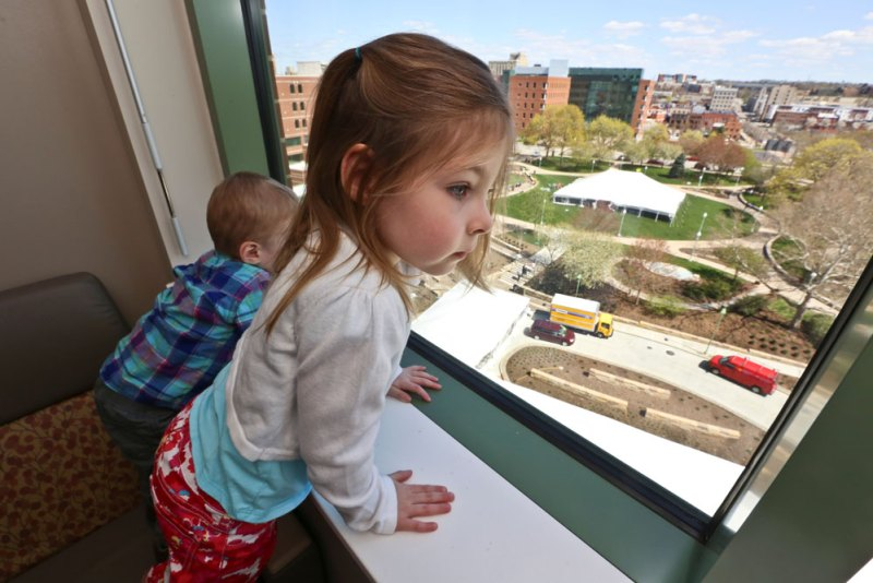 Sam and big sis and NICU grad Bekah check out the expansive views from a NICU room
