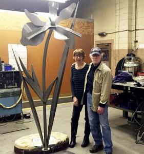 Judith Spater and Stephen Canneto stand next to a Blue Flag Iris in the shop where they were constructed.