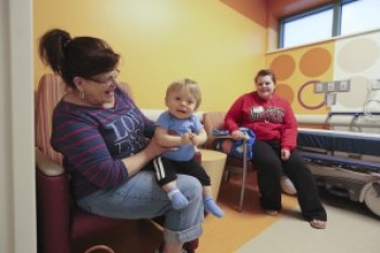 11-month-old Luca, of Vienna, hangs with his grandma and mom, Kate, in a pre-op room before his eye surgery.